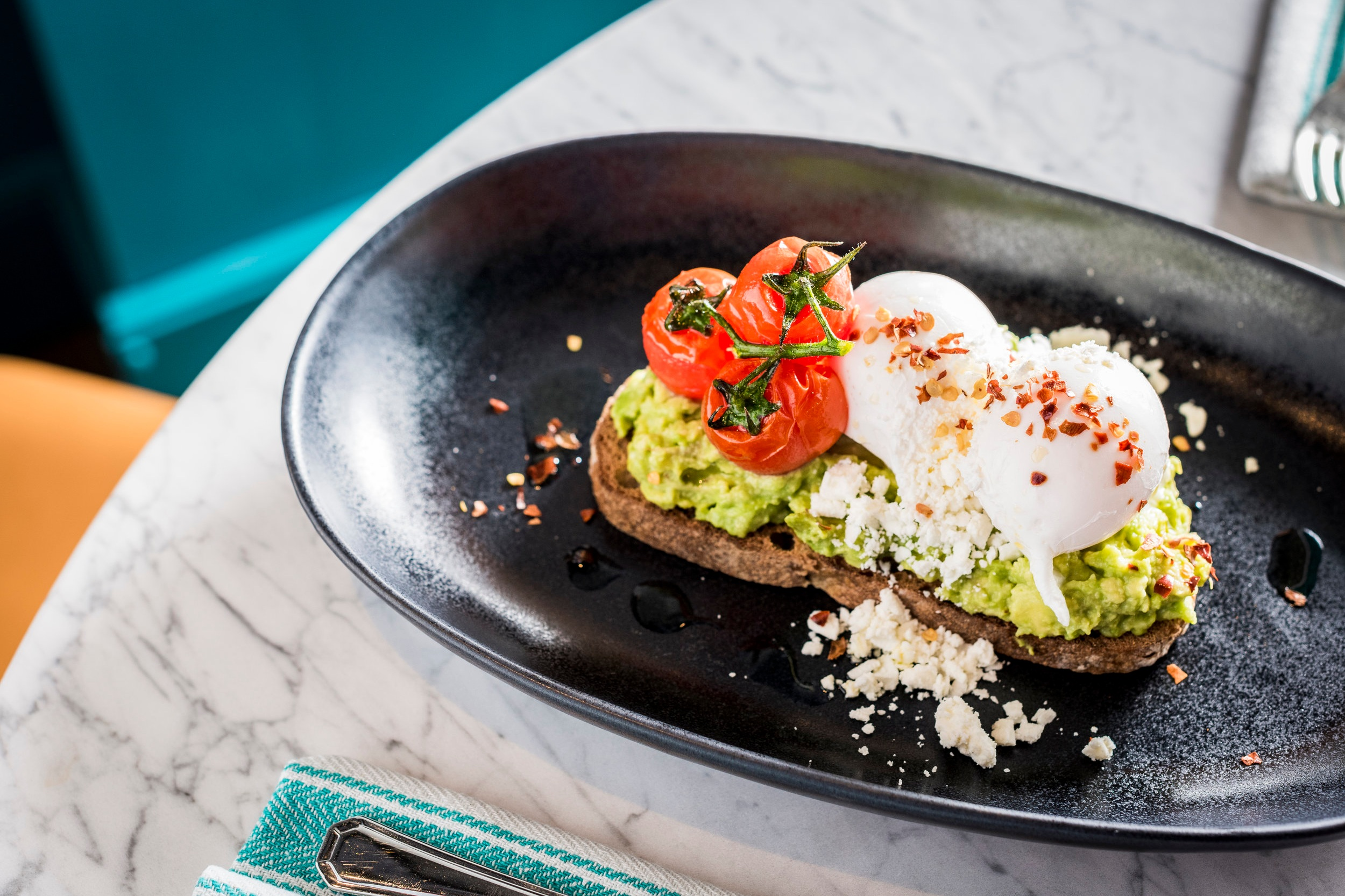Sloane Place Avocado on Toast with Poached Eggs, Feta and Vine Tomatoes (vegan version available)!