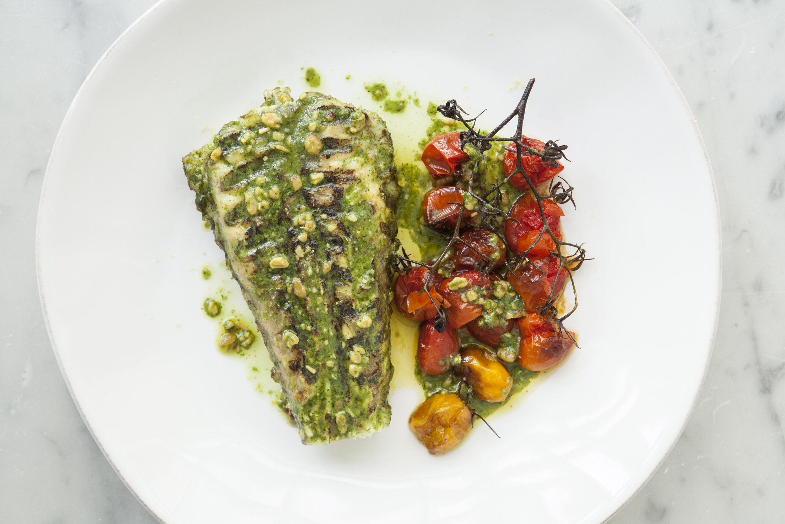 Chargrilled Monkfish Dressed in Pesto with Roasted Vine Tomatoes by Andrew Hayes-Watkins