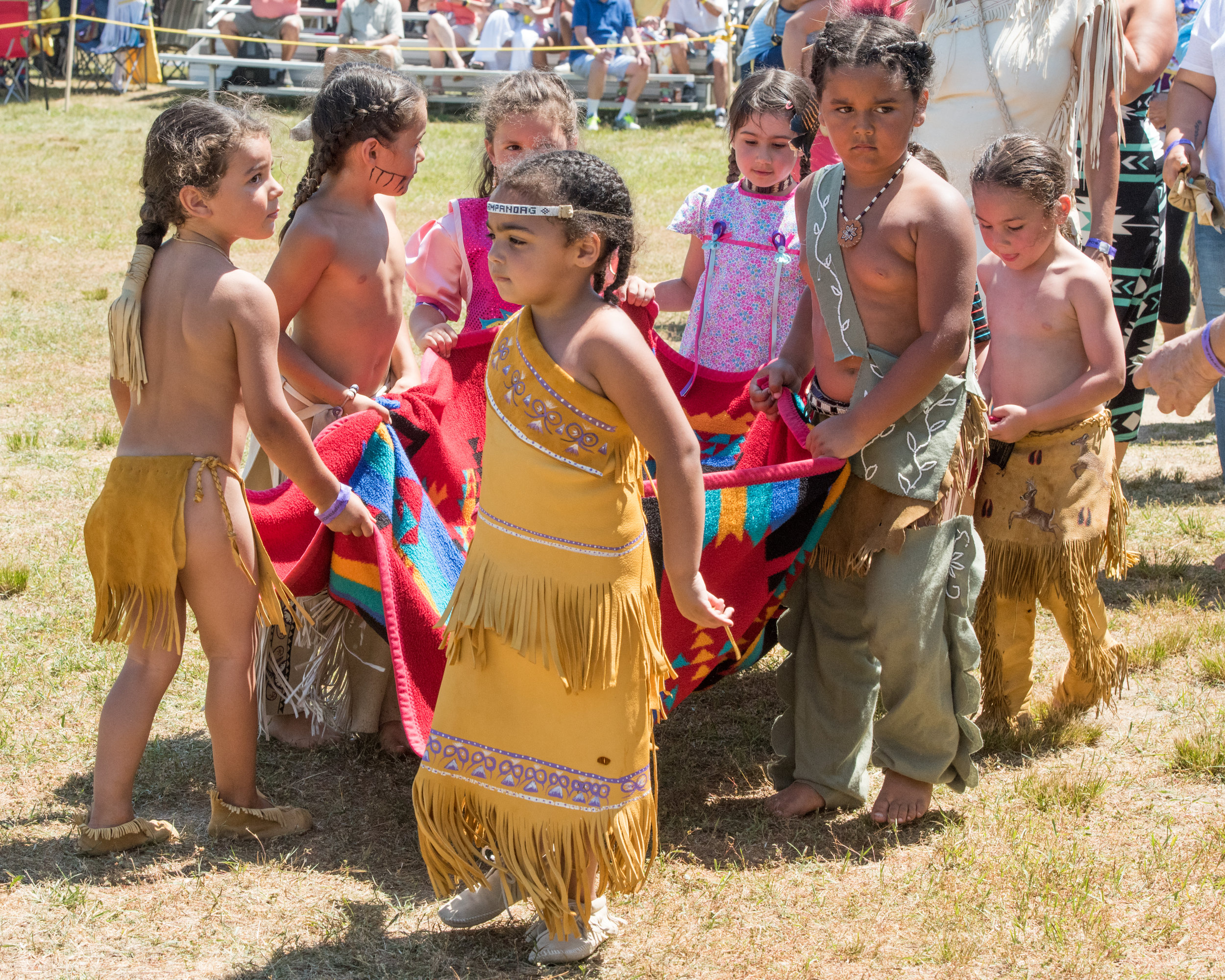 Youth at the Tribe's Annual Powwow collecting donations for the  Mukayuhsak Weekuw : The Children's House, a Wampanoag Language Immersion Nest