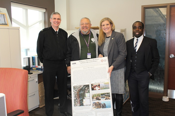 NRD Director Chuckie Green with EPA Director Dunn (center) along with EPA staff with a Poster-Board of the Popponesset Bay Coastal Resilience & Habitat Restoration Project efforts underway in Popponesset Bay.