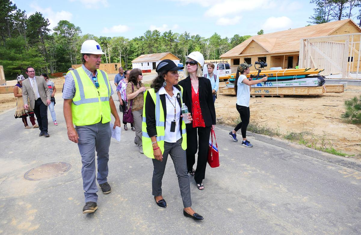 From Left: David Greene, tribal representative with RGB Architects; Tribal Housing Director Michelle Tobey; and General Assistant Secretary for Public and Indian Housing Dominique Blom tour First Light Wampanoag Homes.