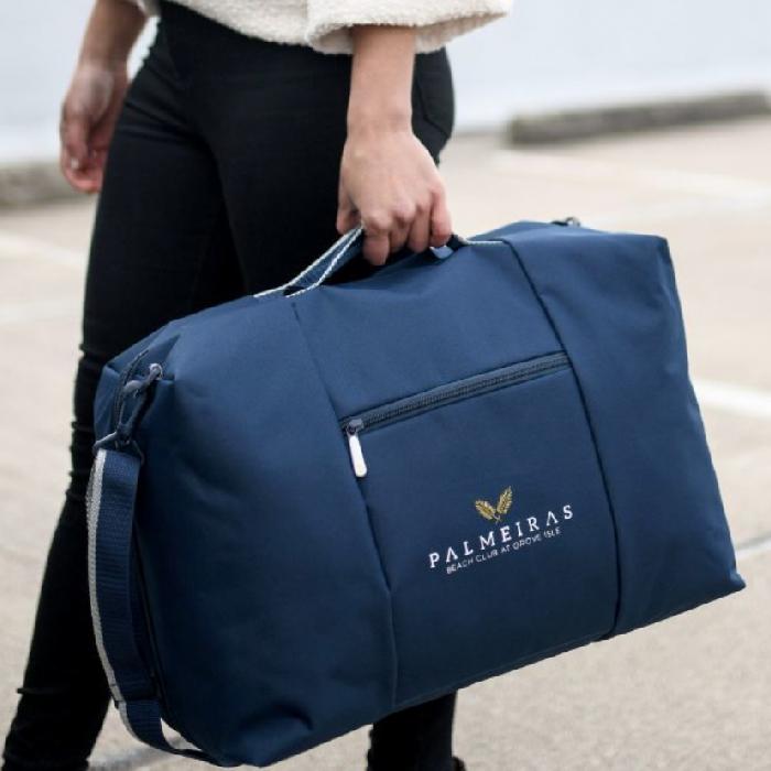 Premium bags, travel drinkware, Moleskine notebooks, executive gifts.