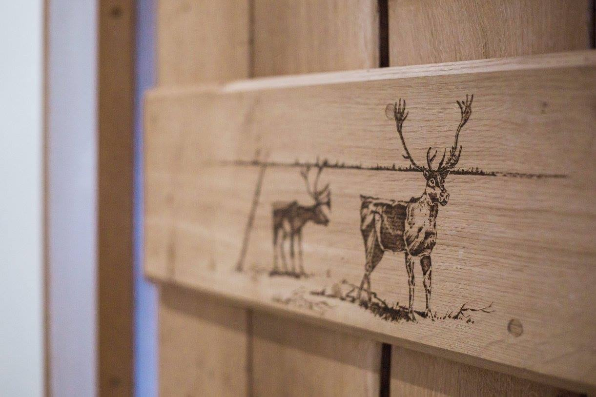 Pyrography reindeer on oak door