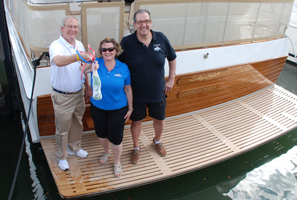 Steve Fithian, Cindy and Michael Ostrow at the christening of LUCKY STAR III, a new Grand Banks 54 Heritage EU.
