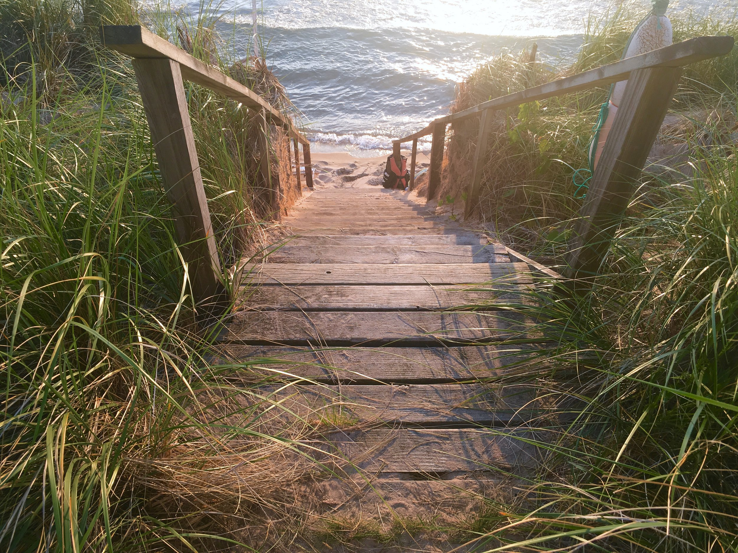 """Every year the winter and the water levels determine the size of the beach and the steepness of the climb down. This summer was the steepest I had seen it. Old stairs were unearthed from the sand by a group of """"the grandchildren."""""""
