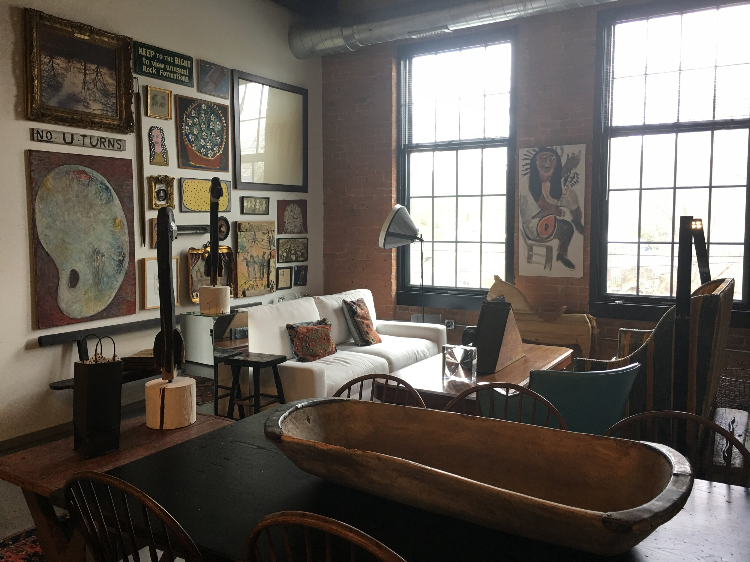 The high ceilings and brick walls lend themselves to the perfect space for Corrine to display her amazing art collection.