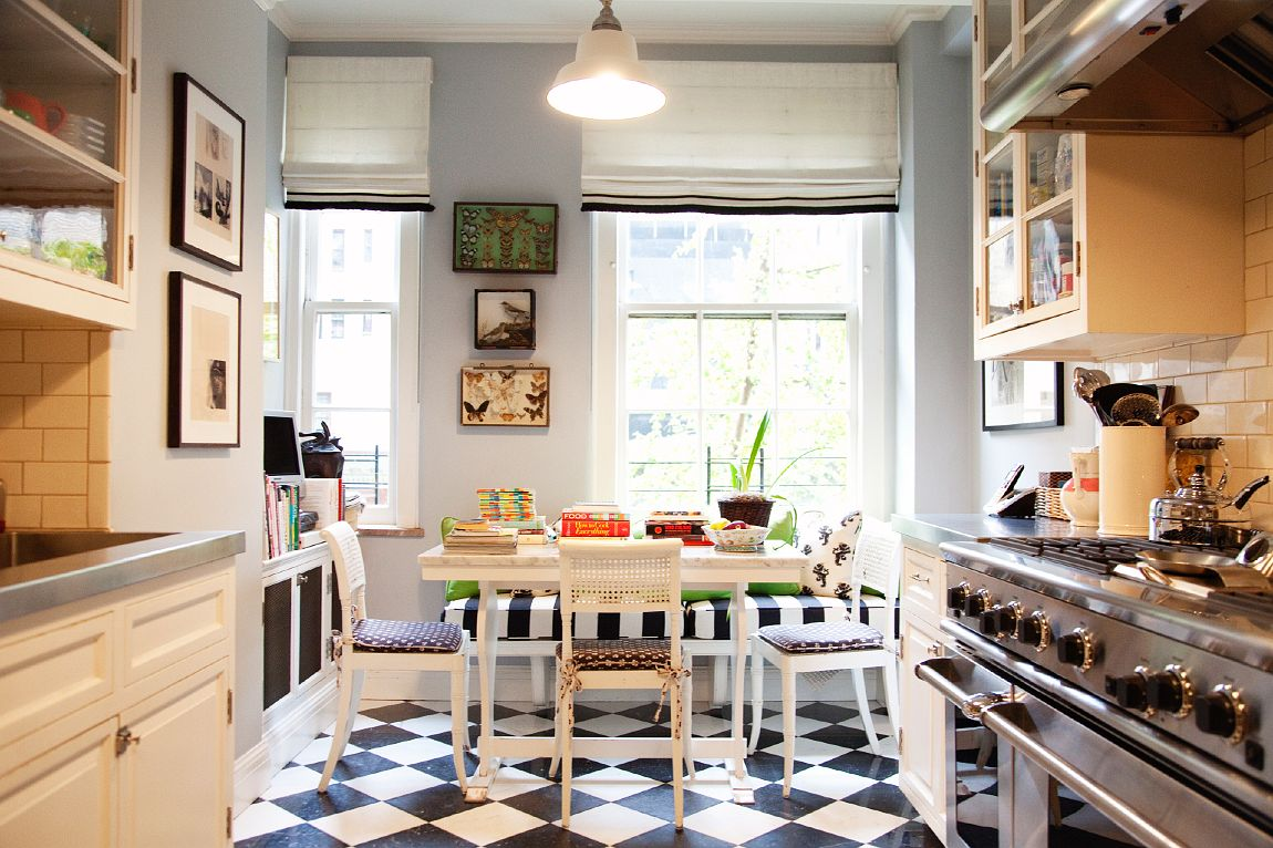 Don't you want to hang out in this kitchen???? I always get drawn into the details of family life. I too have a TV in my kitchen in Vermont. It keeps me company while I create masterpieces or sit and have a cup of tea. Phone, cookbooks, I love it all. photo by the Selby