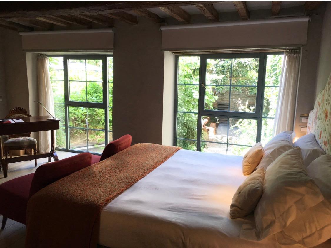 Our romantic hotel room in Florence overlooking a hidden garden