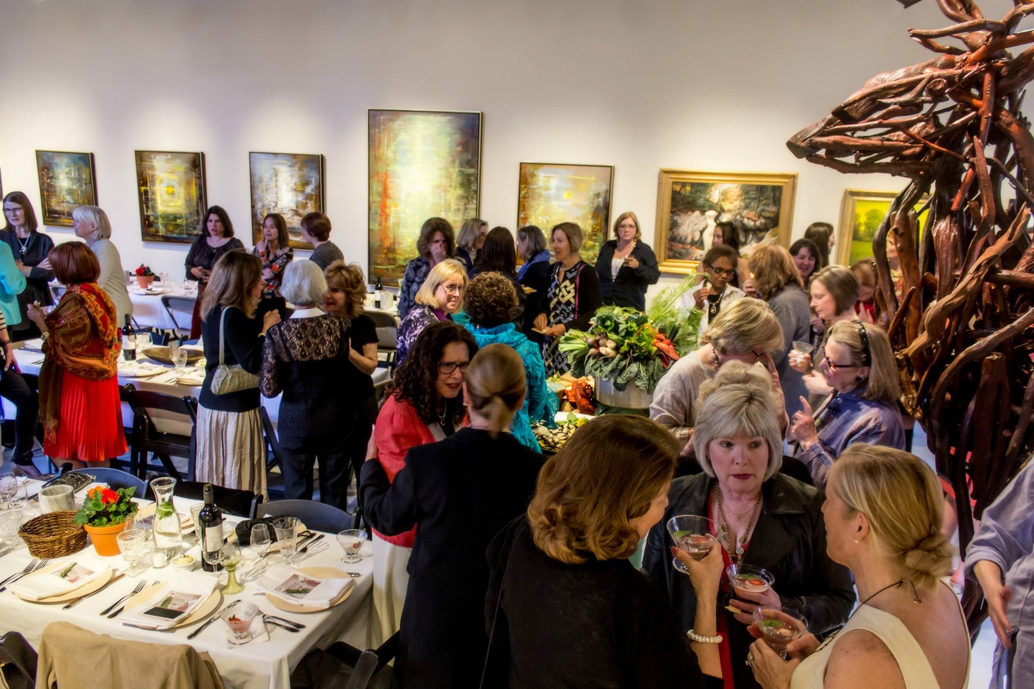 100 women dine together on locally grown food cooked by locally chefs.