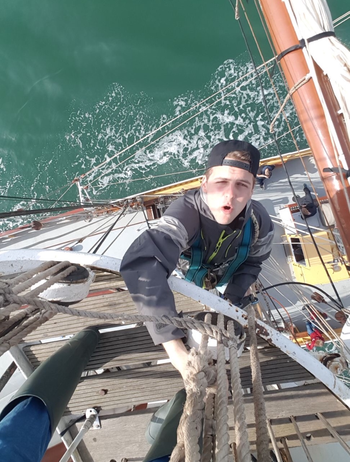 Wasn't I little sick to my stomach when I got this photo of son Colin on a European race climbing the mast. The kid is a banker, can't he stay safely on the ground in a bank for God's sake! Gray Hair!