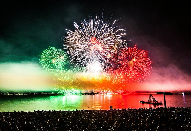 Crowd watching fireworks over water in Argentina