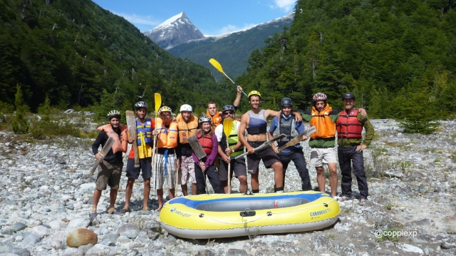 Tour group stand in front of raft in Argentina