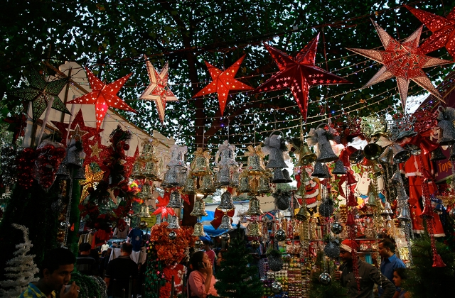 Hanging red stars during Christmastime at local market in India