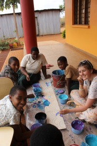 Students and volunteers enjoy painting and each other's company