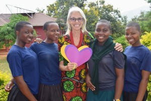 Peace Corps volunteer Susan poses with a group of SEGA students for Valentine's Day.