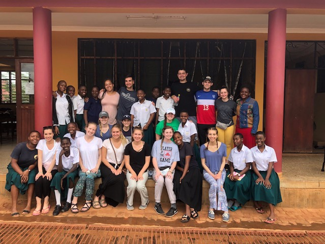 The Penn State Group poses for a picture with their new friends after the cultural exchange.