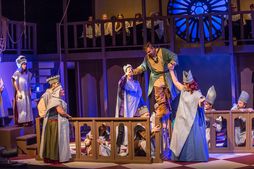 """Gargoyles and statues, whom Quasimodo (Ryan Peter Dziuba) converses with, help him navigate a ledge high on the cathedral in a scene from Waukesha Civic Theatre's """"The Hunchback of Notre Dame."""""""