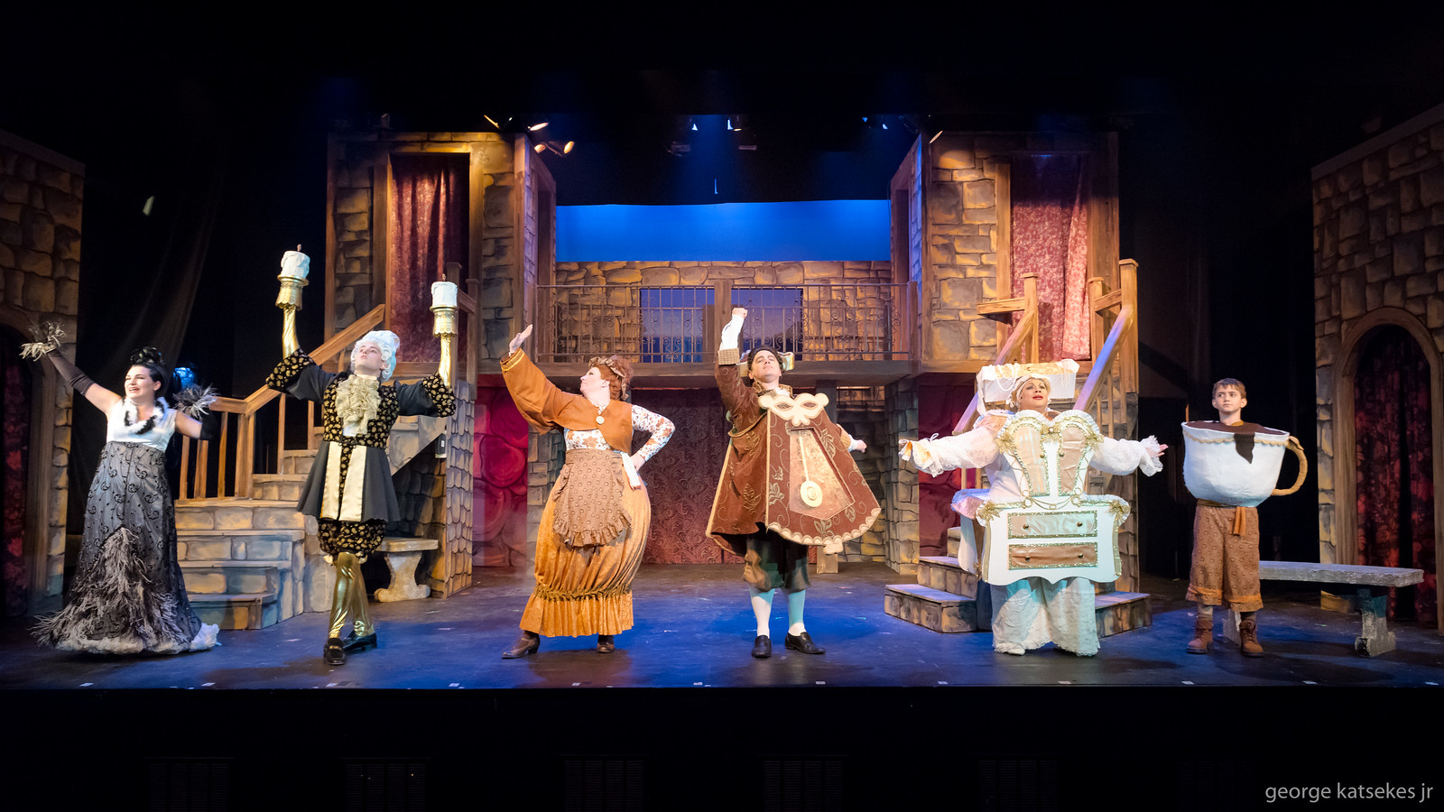"""Babette (Lydia Rose Eiche), Lumiere (Eric Welch), Mrs. Potts (Marcee Doherty-Elst), Cogsworth (Corey Richards), Madame De La Grand Bouche (Sharon Tyler) and Chip (John Batory) sing about how life will be when they shed their objects and become people during the """"Human Again"""" song in a scene from Sunset Playhouse's """"Beauty and the Beast."""""""