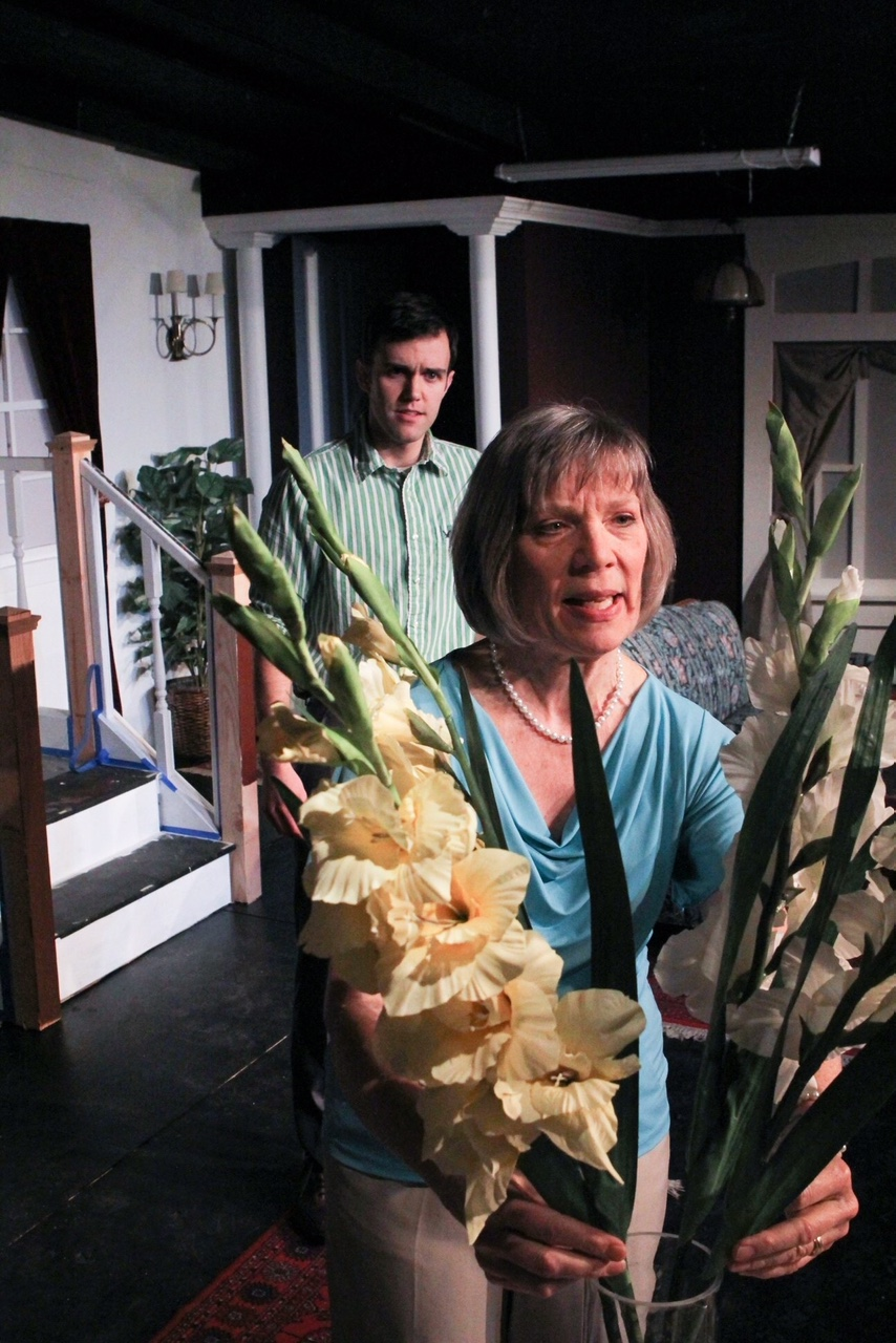 """Evelyn (Sara Sarna) busies herself with her flowers while her son Avery (Jason Nykiel) tries to get her to see the reality of her situation in a scene from Lake Country Playhouse's """"37 Postcards."""""""