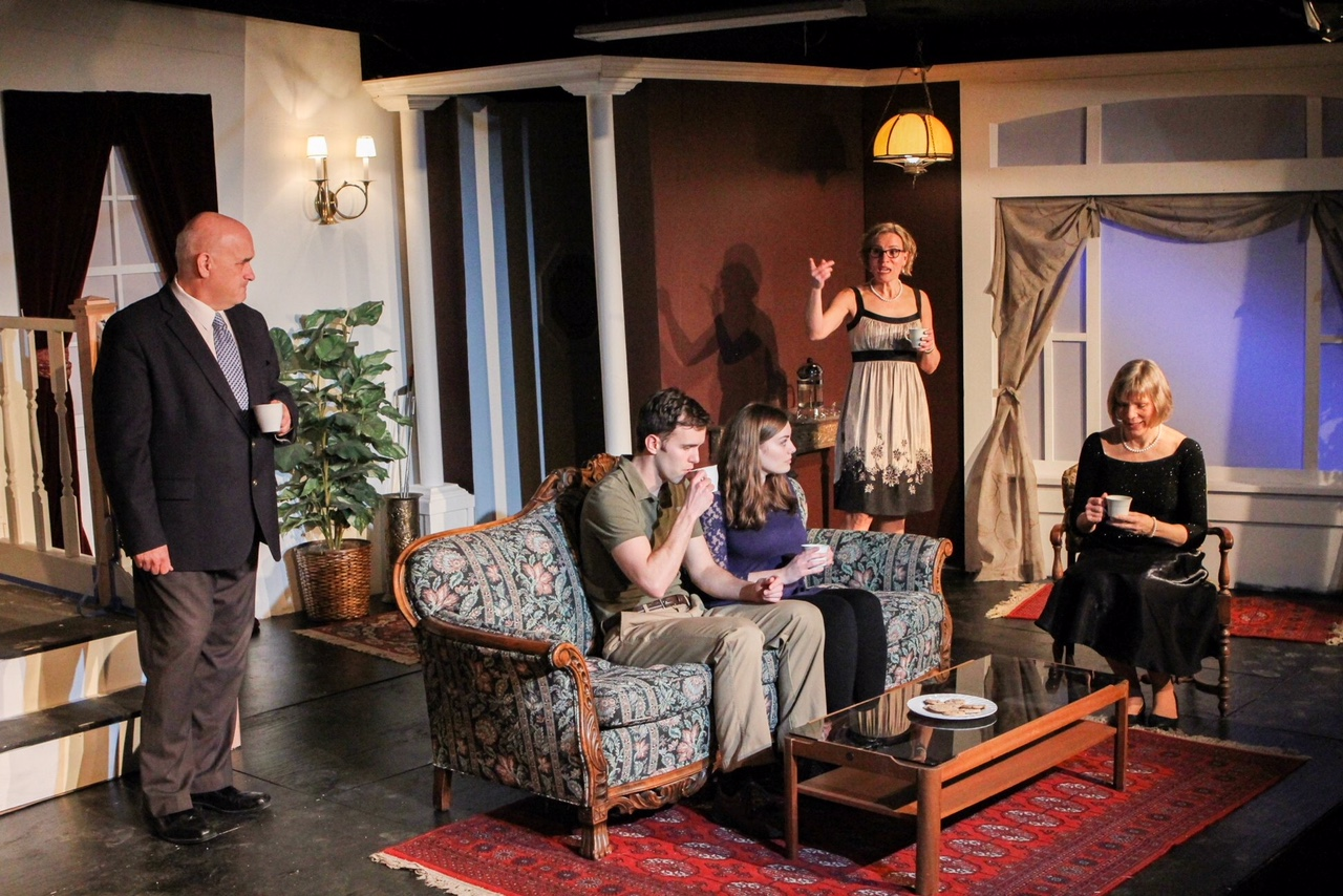 """Avery (Jason Nykiel) and his fiancée, Gillian (Alex Sturycz) meet together for the first time with Avery's family that includes, from left, his dad Stanford (Mike Crowley), Aunt Ester (Laura Larson) and his mother Evelyn in a scene from Lake Country Playhouse's """"37 Postcards."""""""