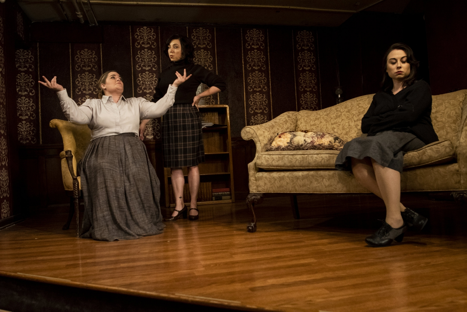 "Mrs Lily Boeche, left, (Brittany Boeche) is confronted by her niece Martha Samantha Paige, center, and Karen (Kira Renkas) in a scene from Outskirts Theatre Company's ""The Children's Hour."""