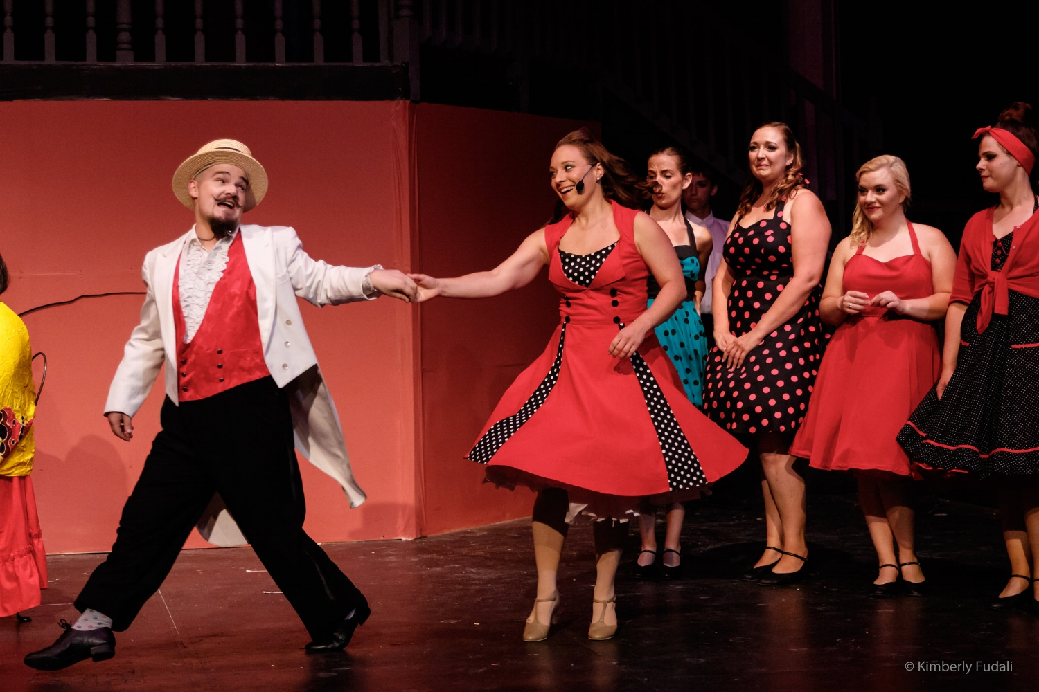 "Augustin Magaldi (Gregory Malcolm) dances with Eva Duarte (Lindsay Woppert) in a scene from West Allis Players' ""Evita."" (Photo by Kimberli Fudali)"