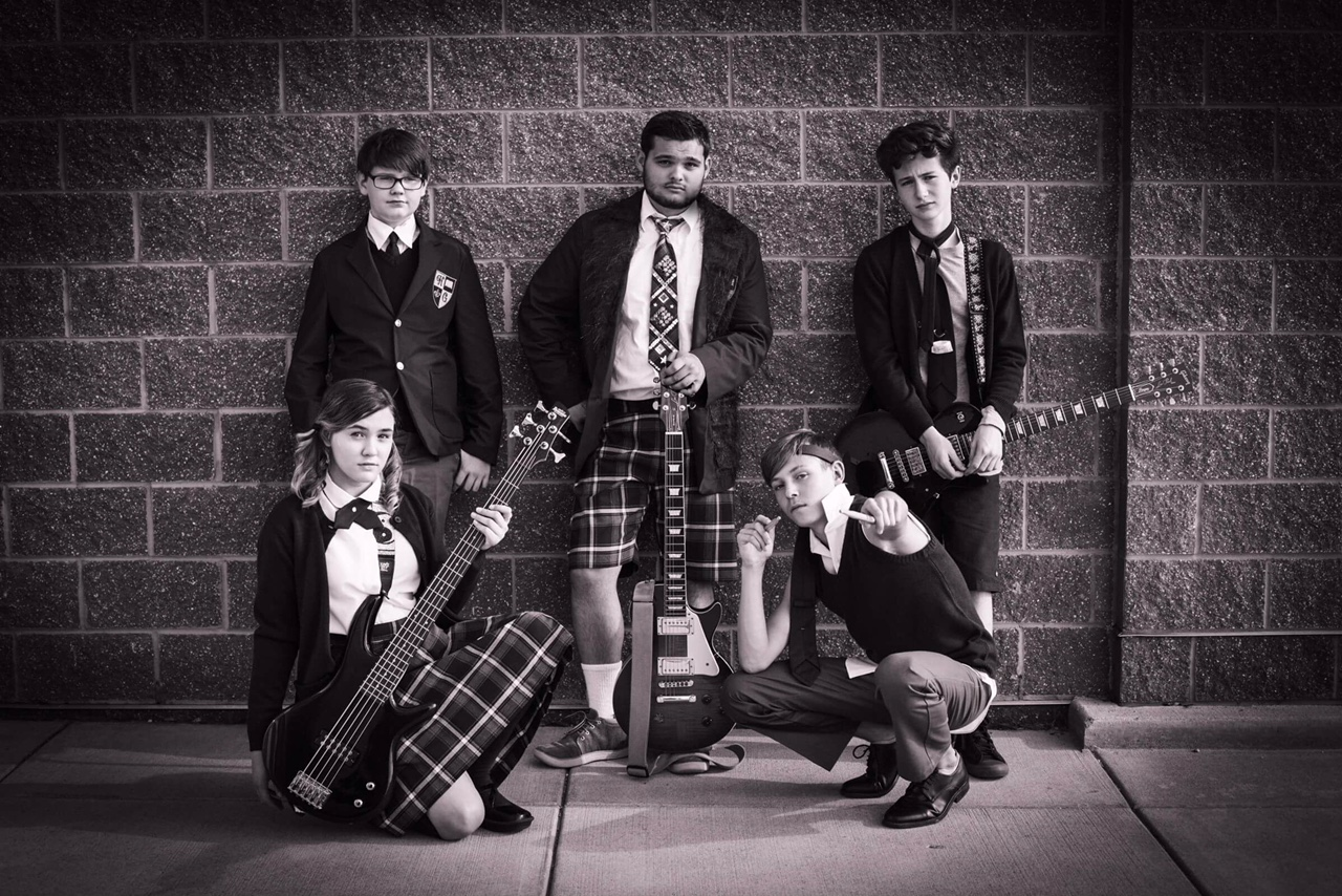 """Members of the School of Rock band strike a pose befitting their rock star status in """"The School of Rock,"""" presented by Sudbrink Publications. Pictured are, from left top, Lawrence (Ryan Vanselow), Dewey (Thomas Madrzak), Zack (Cian Radcliffe), bottom, Katie (Ivy Broder) and Freddy (Zander Tomes)."""