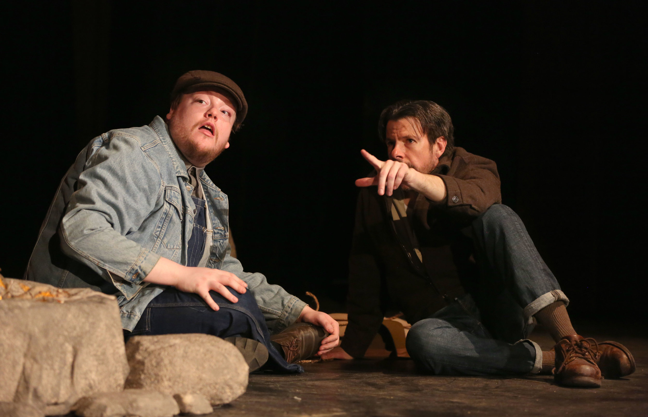 """George (Paul Steinbach) points out an imaginary dream home to Lennie (Nicholas Callan Haubner) in a scene from the Musical Masquers """"Of Mice and Men."""""""