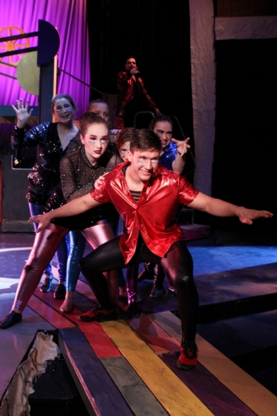 "Joseph Hoelzer leads The Players in a scene from Lake Country Playhouse's and University of Wisconsin-Waukesha's presentation of ""Pippin."""