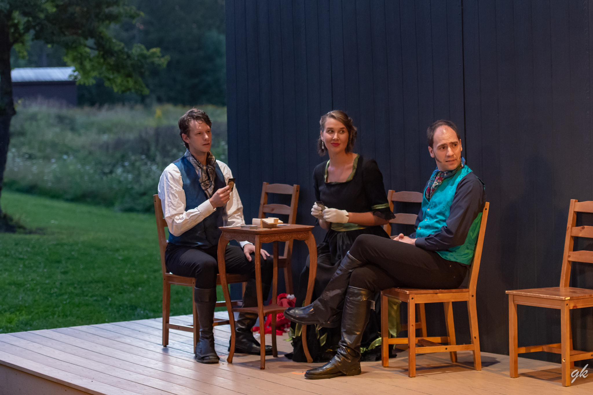 """Mr. Darcy (JJ Gatesman), Miss Bingley (Genevieve Breitbach) and Mr. Bingley (Matthew Collie) play a game while listening in on a conversation in a scene from Summerstage's """"Pride and Prejudice."""""""