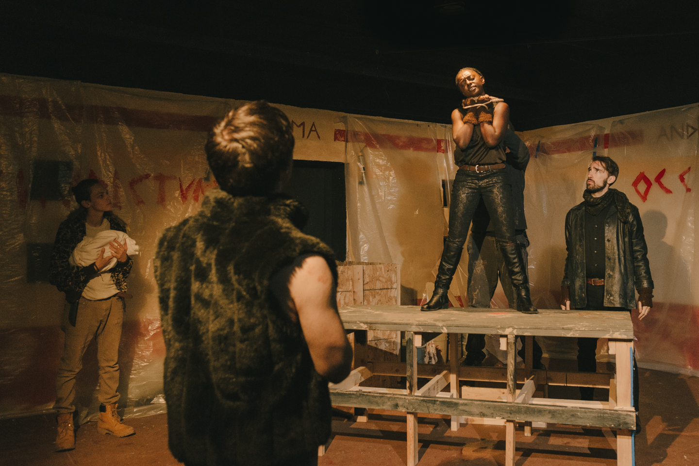 "Saturninus (Kyle Conner) looks up at Aaron (Brittany Faye Byrnes) who speaks defiantly before being murdered in a scene from Voices Found Repertory's ""Titus Andronicus."""
