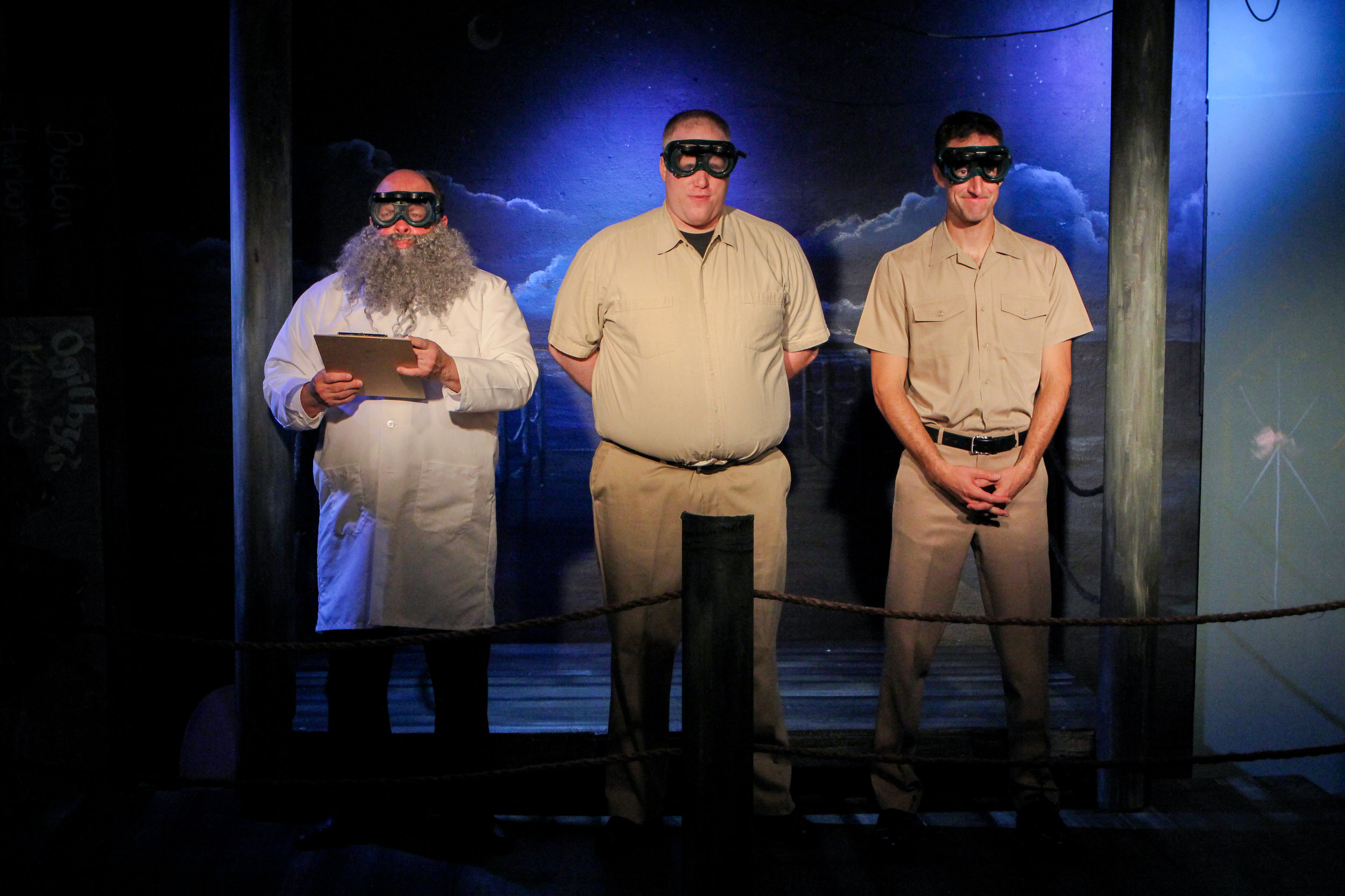 "Three men (from left, Kelly Vance, John Reilly and Dustin Nolan) watch the testing of nuclear bomb in a scene from Lake Country Playhouse's ""Red Herring."