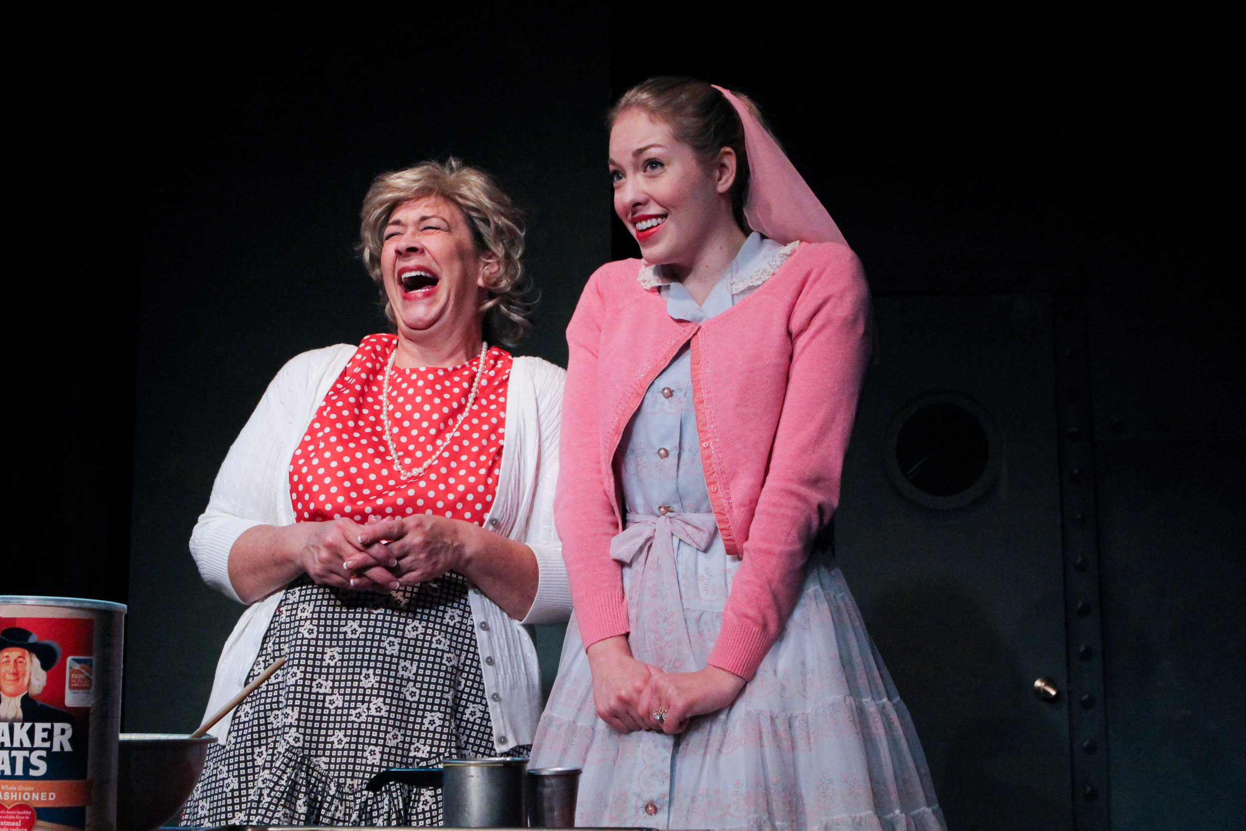 "Mrs. McCarthy (Rebecca Richards) shares a light moment with her daughter, Lynn (Stephanie Nilsen), in a scene from Lake Country Playhouse's ""Red Herring."""