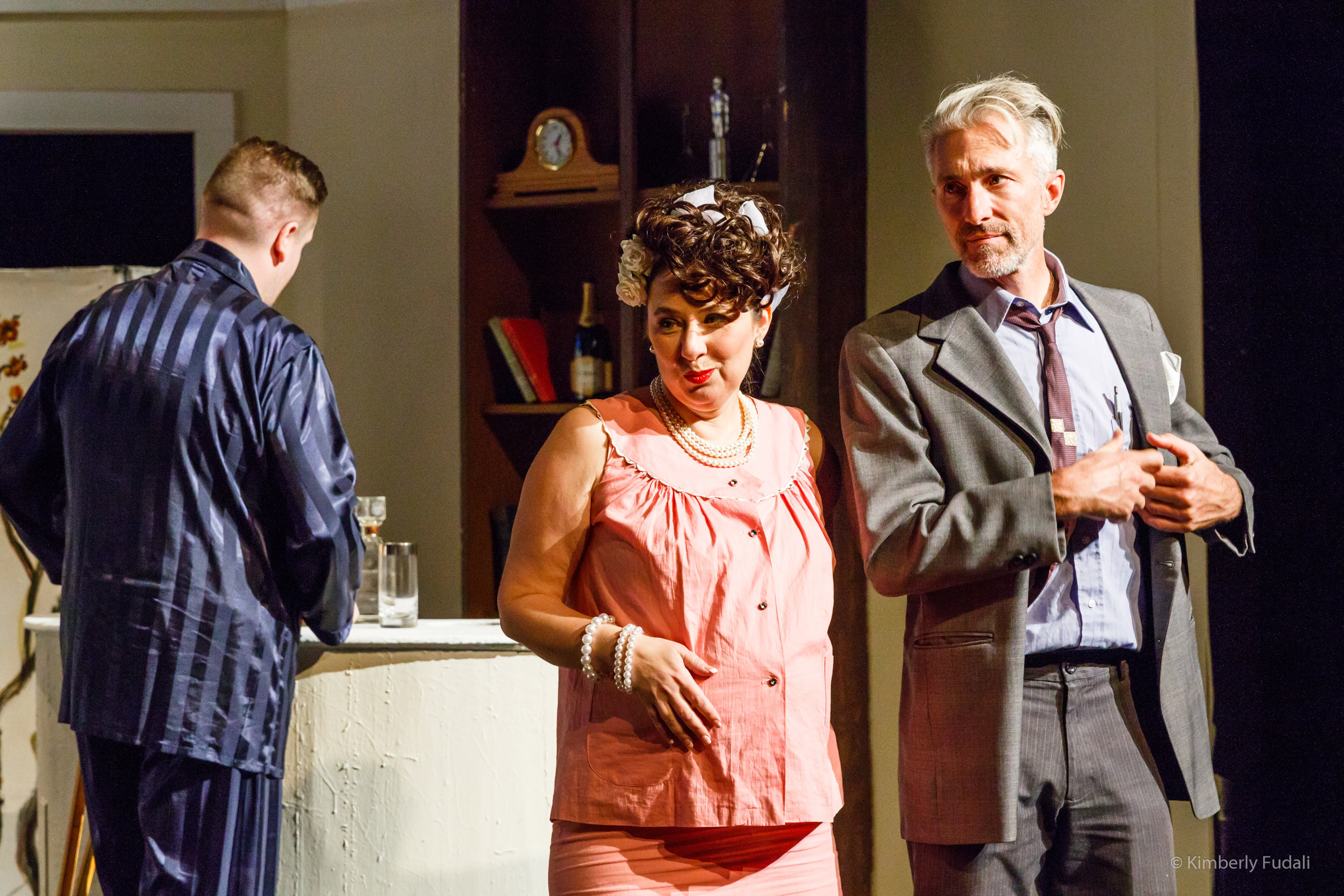 "A pregnant Mae (Joanna Langworthy) and her husband Gooper (The Skrauss) meet in Brick's room while Brick (Nicholas Callan Haubner) gets a drink in a scene from West Allis Players' ""Cat on a Hot Tin Roof."""