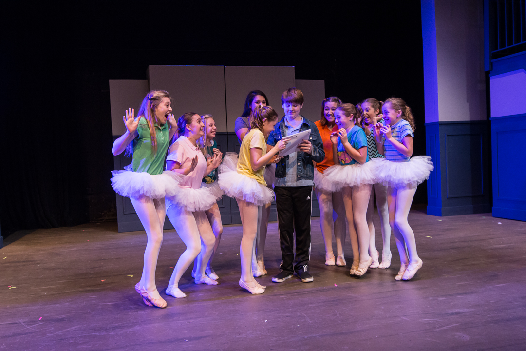 "Billy Elliot (Ryan Vanselow) meets with the excited ballerina girls in a scene from Waukesha Civic Theatre's ""Billy Elliot."""