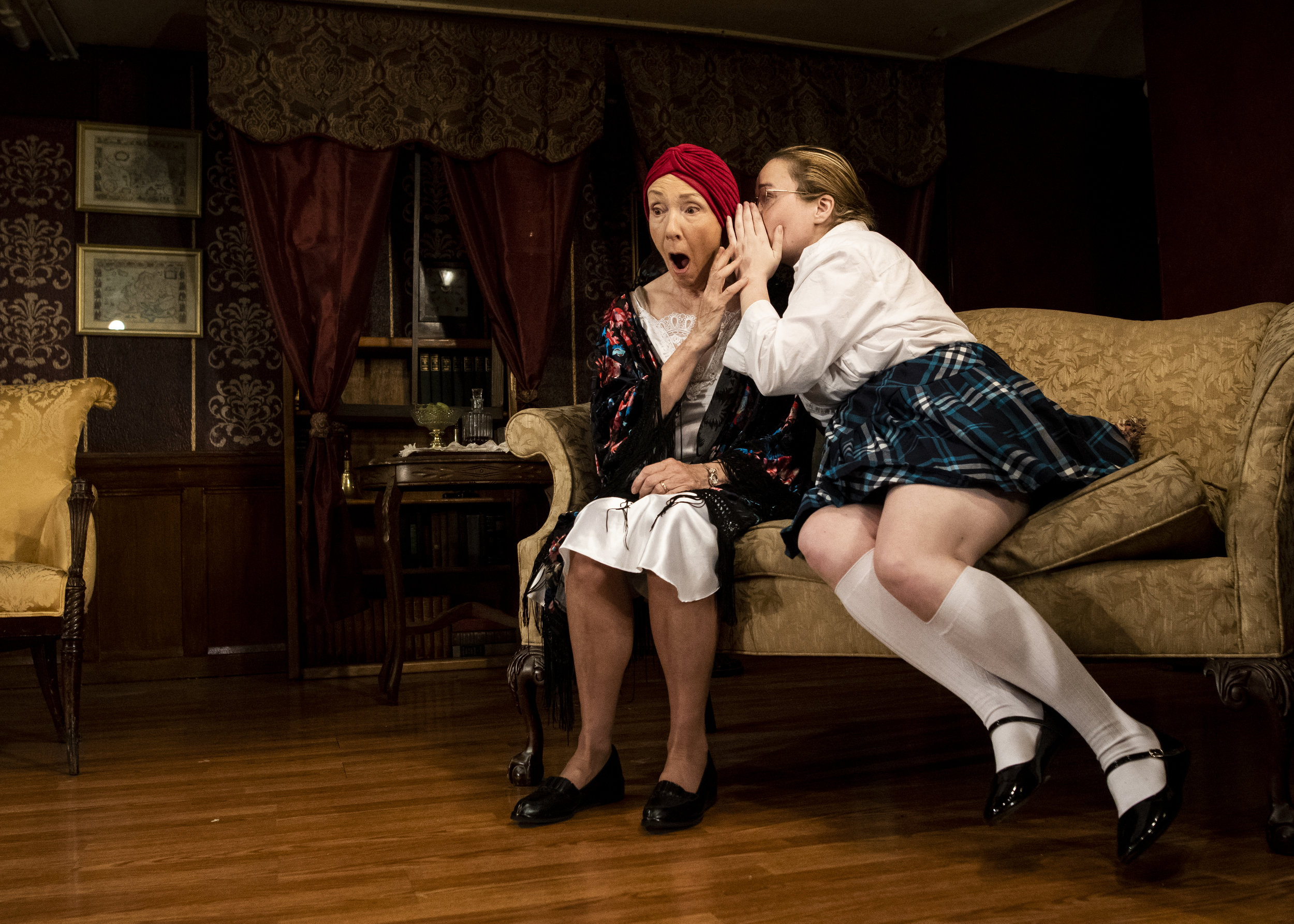 "Mary (Ashley Retzlaff) whispers a horrible secret to her grandmother (Mary Buchel) in a scene from Outskirts Theatre's ""The Children's Hour,"" our choice for best drama of 2018."
