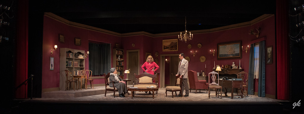 "Matthew Carr's handsome set provides a fine backdrop for the characters in Agatha Christie's ""A Murder is Announced"" at Sunset Playhouse. Pictured are: Letitia (Tamara Martinsek), Phillipa (Stephanie Nilsen) and Patrick (Evan Prier)."