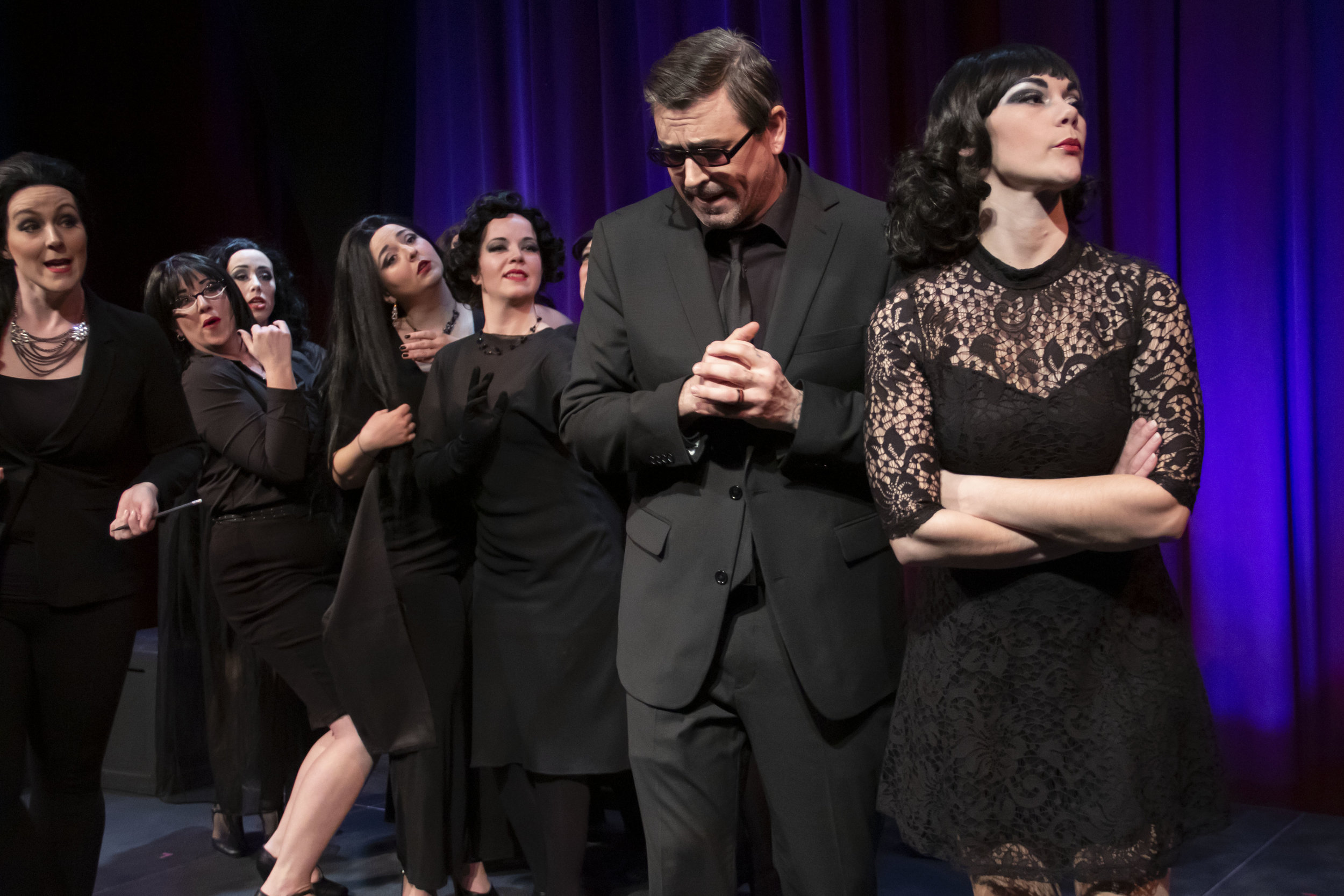 "Guido (Timothy J. Barnes) has a hard time juggling all the women in his life including, from left, Lina (Carrie Gray), Stephanie (Marcee Doherty-Else), Carla (Samantha Sostarich), Our Lady of the Spa (Hannah Esch), Guido's Mother (Laura McDonald) and Luisa (Rae Elizabeth Pare) in a scene from Theater Red's ""Nine."""