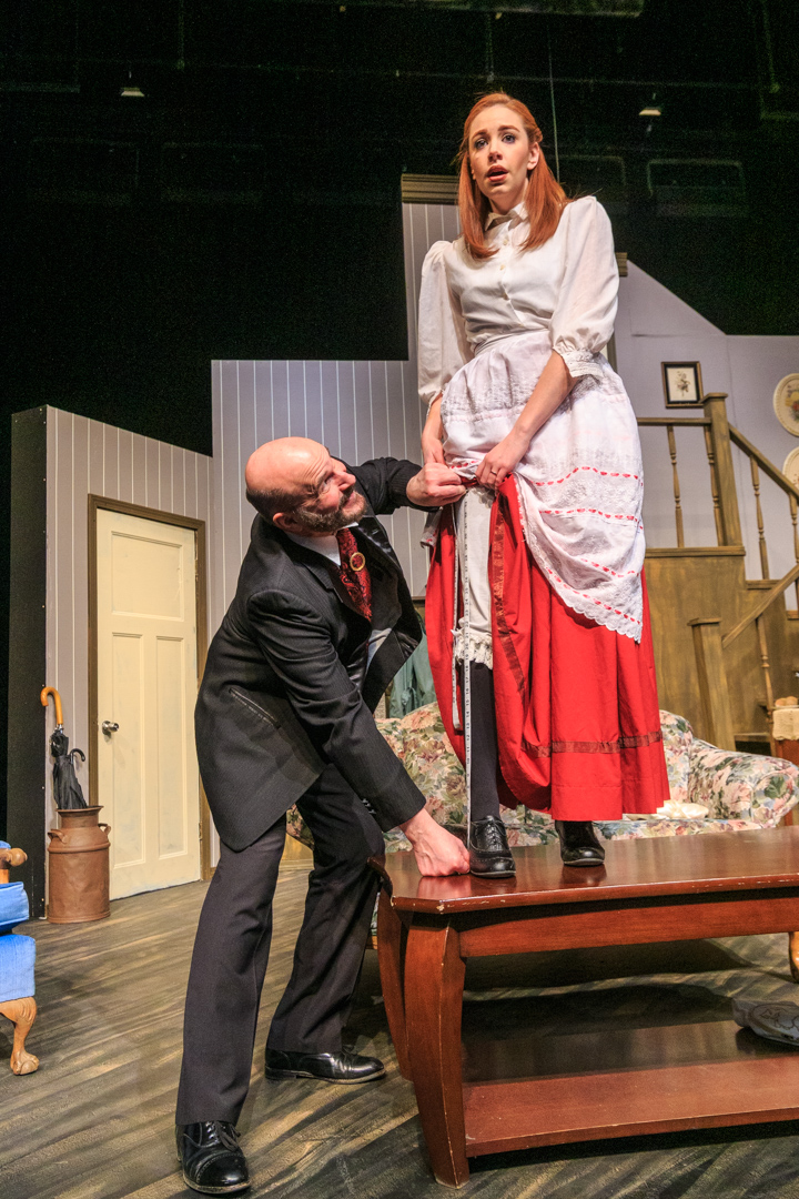 "The poet Versati (Michael Chobanoff) measures up Louis (Brenda Poppy) in a scene from Waukesha Civic Theatre's ""The Underpants."""