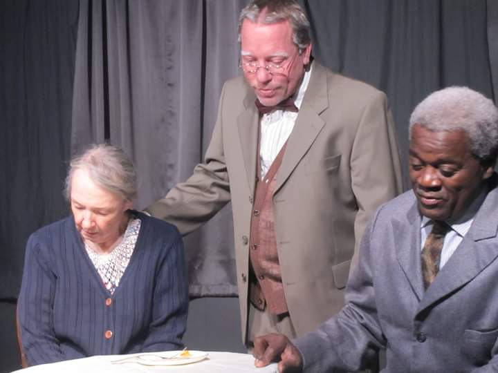 "Daisy Werthan (Mary Buchel), Boolie Werthan (Scott Sorenson) and Hoke Coleburn (Andre Lee Ellis) in a scene from Village Players' ""Driving Miss Daisy."""