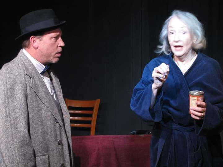 "Daisy (Mary Buchel) complains to her son, Boolie (Scott Sorenson) that her driver has stolen a can of salmon in a scene from Village Playhouse's ""Driving Miss Daisy."""