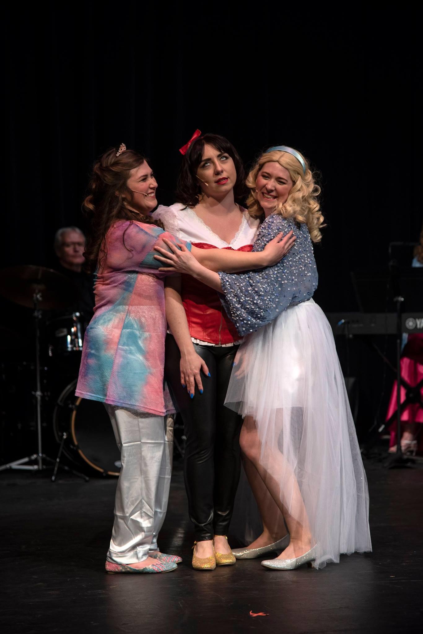 Snow White (Samantha Paige) gets hugs from Sleeping Beauty (Gabriella Ashlin, left) and Cinderella (Emma Losey).