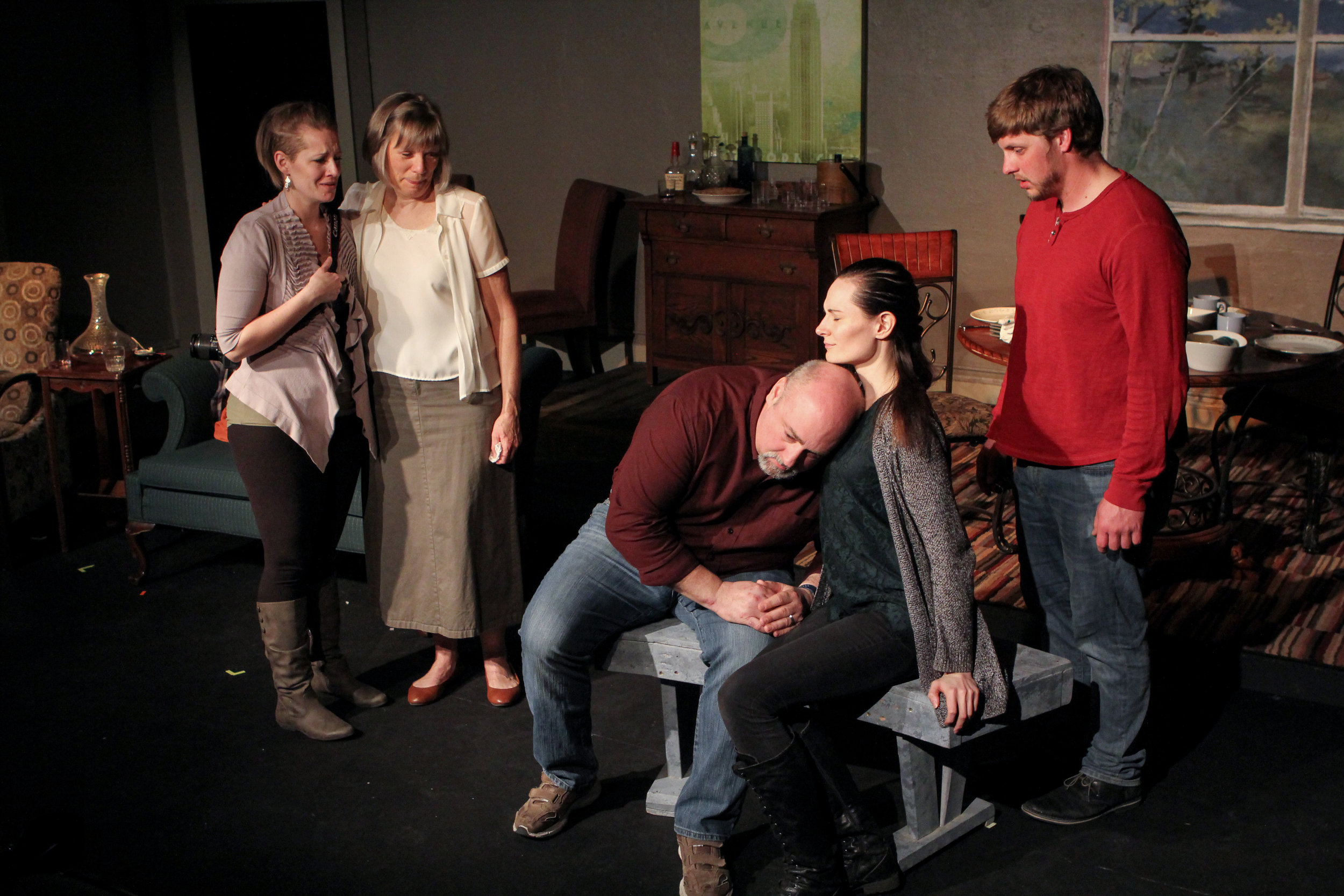 In a touching scene, Jack's father (Bob Fuchs) listens to his son's heart beating in Joy (Alyssa Falvey) supported by his daughter Sammy (Cayla Anderson) and wife (Sara Sarna). His son Jack (Zachary Klahn) watches over his family.