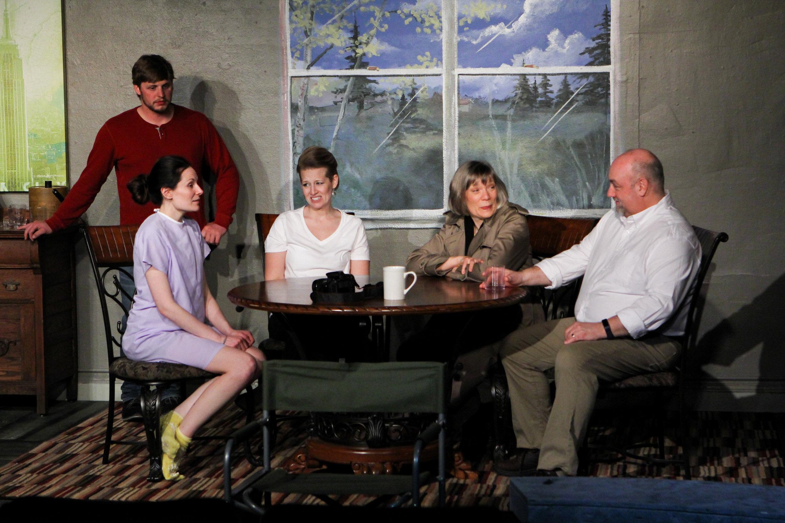 Jack (Zachary Klahn) hovers over his family — Sammy (Cayla Anderson), his mom (Sara Sarna) and dad (Bob Fuchs) as they meet with the recipient of his heart, Joy (Alyssa Falvey), left.