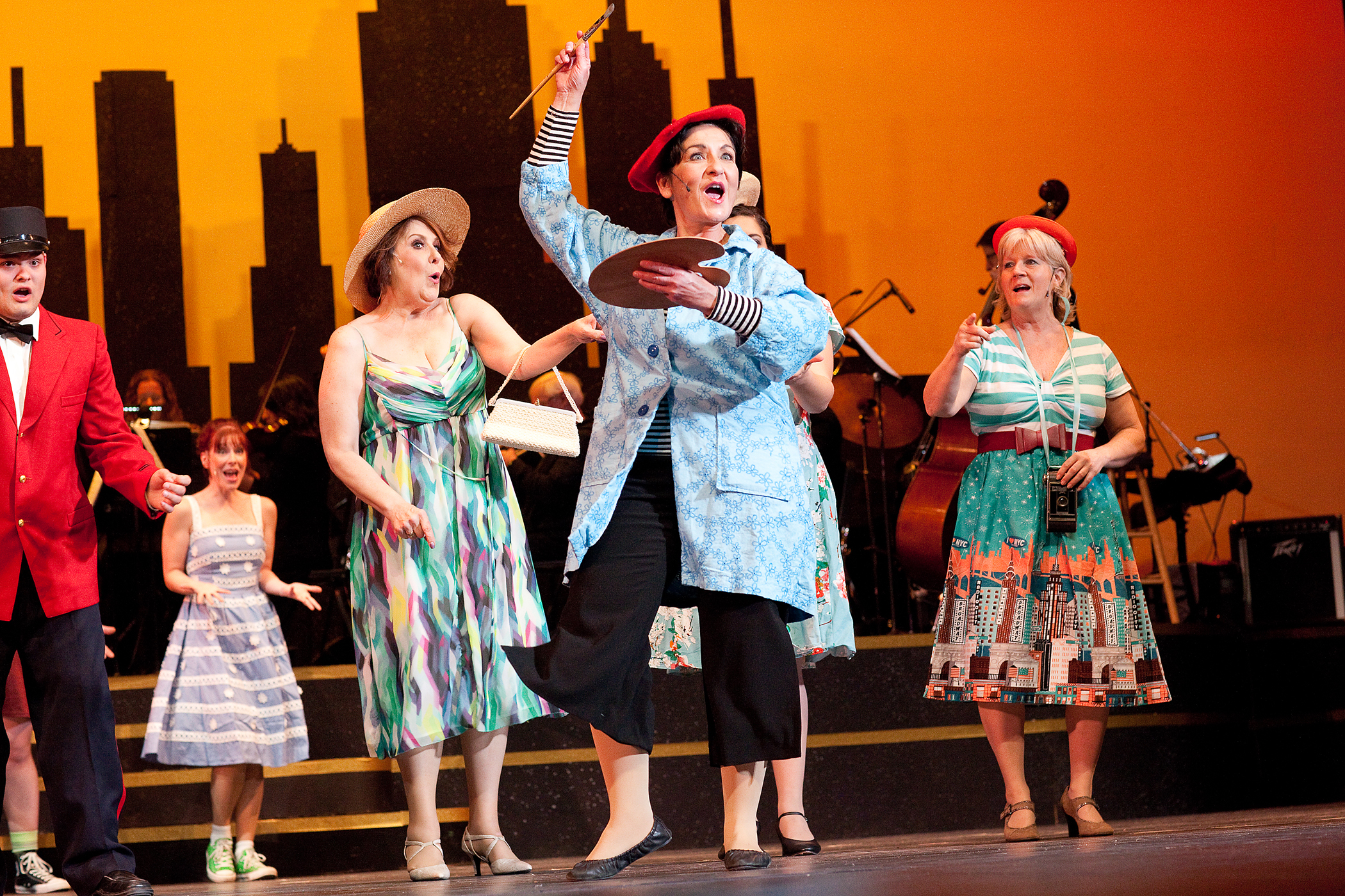 """Denizens of Greenwich Village appear in the opening scene of Falls Patio Players """"Wonderful Town."""" Pictured are, from left, Tom Madrazak, Eva Shuelke, Ann Brower, Jennfer Sciuti and Laura Ciletti."""