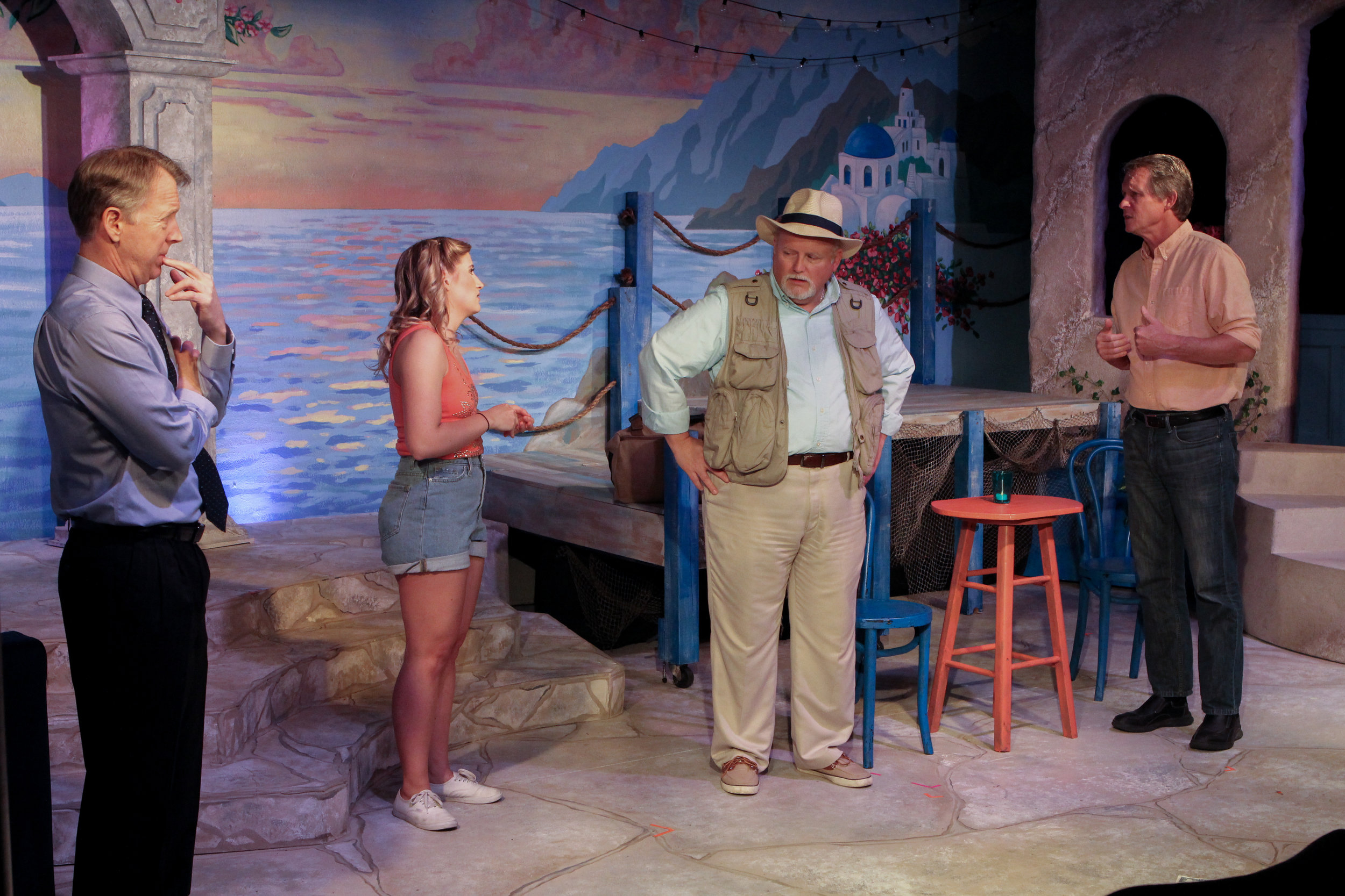 """Sophe (Courtney Denzer) meets with three men — Harry, Bill and Sam (from left, Jim Halverson, Marty Graffenius and Joe Nolan) — one of whom she thinks is her dad in a scene from Lake Country Playhouse's """"Mama Mia!"""""""