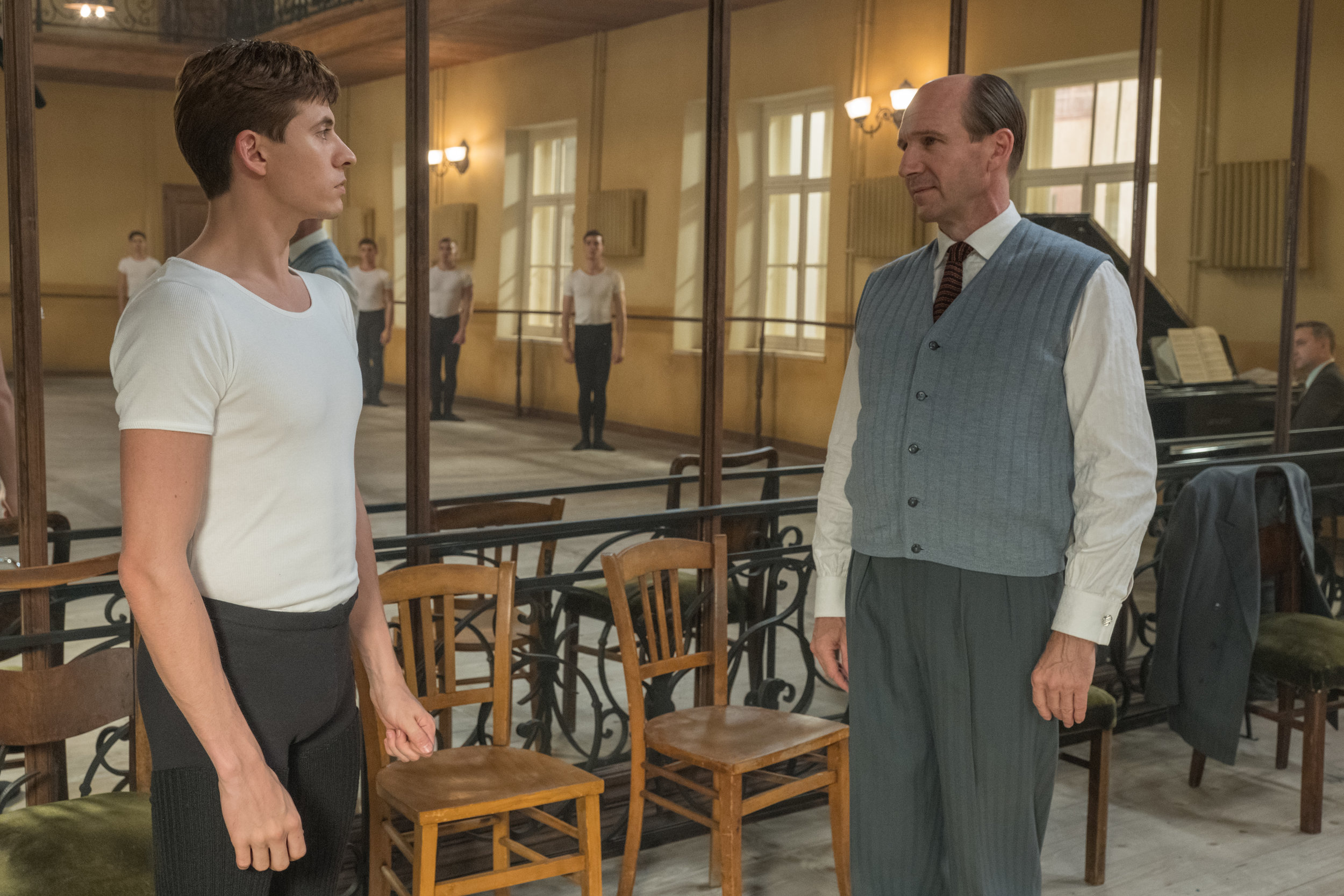 "Oleg Ivenko as Rudolf Nureyev, and Ralph Fiennes as his dance teacher star in ""The White Crow."""