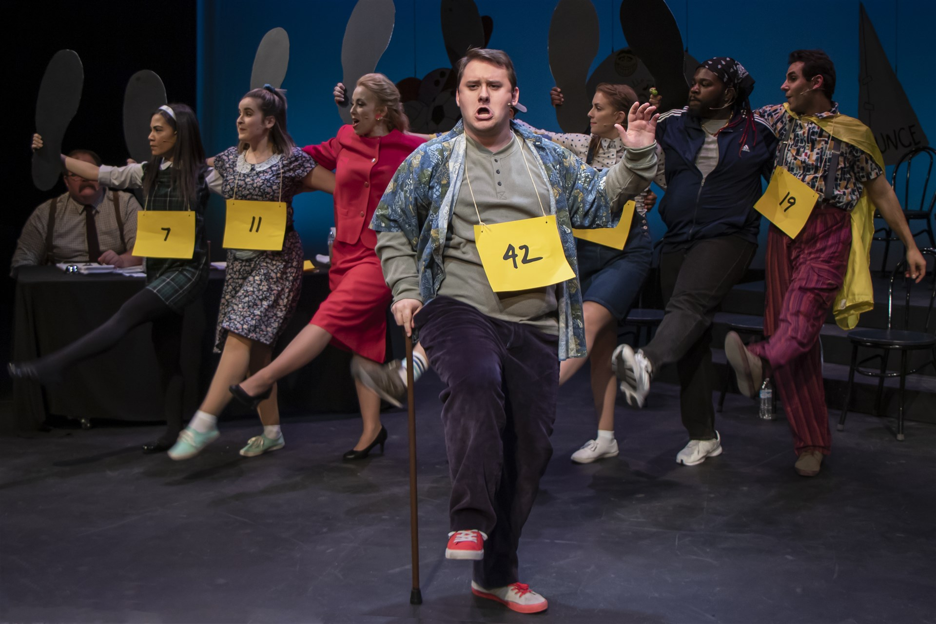 William (Gage Paterson) demonstrates his Magic Foot in a song and dance number supported by, from left, Marcy (Ashely Oviedo), Olive (Ava Bush), Rona (Samantha Sostarich), Chip (Romesh Alex Jaya), Mitch (Ernest Bell) and Leaf (Adam Quataishat).