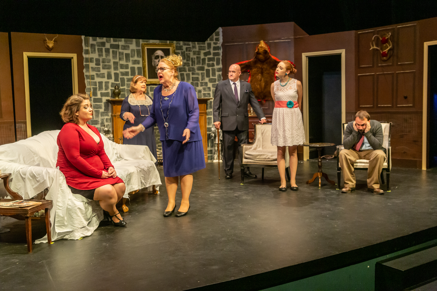"Mandi Veeder as Rosalind Barstow, Joyce Sponcia as Miss Barnsdale, Tammy Vrba as Lady Barbara Fenwick, Mike Crowley as Orion Leduc, Brenda Poppy as Dora Dunstock,and Jim Donaldson as Jeff Barnett, from left, in a scene from Waukesha Civic Theatre's ""Why Bump Off Barnaby?""  Photos by Van James Photography"