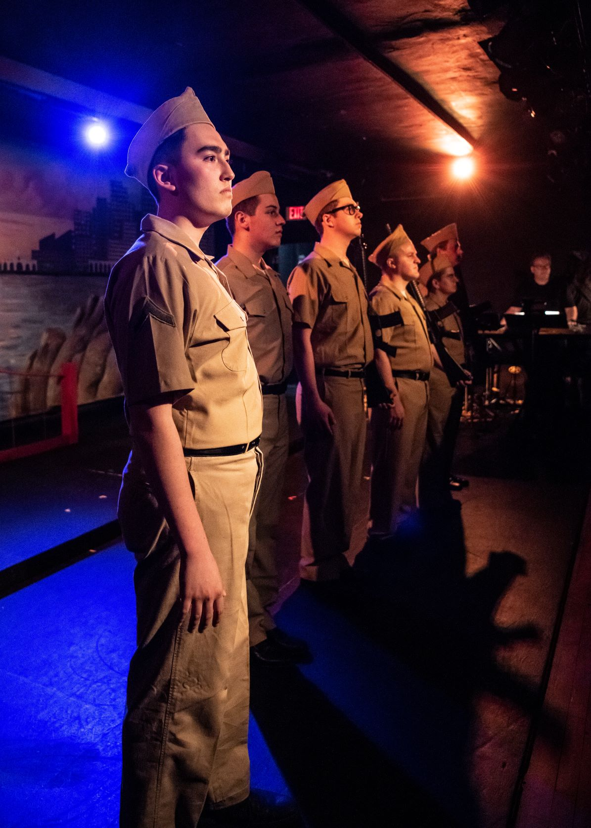 """Birdlace (Eamon Schiro, foreground) stands with his fellow Marines in Lake Country Playhouse's """"Dogfight."""""""